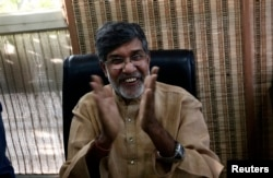 Indian children's right activist Kailash Satyarthi speaks with the media at his office in New Delhi, Oct. 10, 2014.