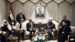 United Nations special envoy to Syria Kofi Annan (3rd Left) meets with Ahmad Badr Al Din Hassoun, Syria's Grand Muft (2nd Right), in Damascus, Syria, March 11, 201