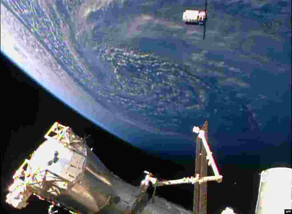 This NASA TV handout image shows the Orbital Sciences Corporation's unmanned Cygnus cargo ship arriving at the International Space Station on the company's first regular supply mission to the research outpost.
