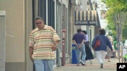 People walk down one of the main streets in Teaneck, New Jersey, where small businesses are having a rough go of it during this latest economic downturn, September 2011.