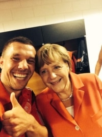 Lukas Podolski and Angela Merkel.