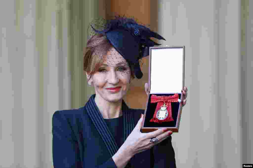JK Rowling poses for pictures after she was made a Companion of Honour by Britain's Prince William during an Investiture ceremony at Buckingham Palace, in London.