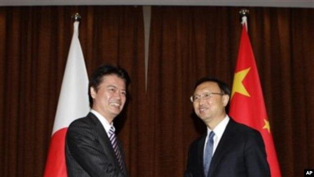 Japanski šef diplomatije Koićiro Gemba i njegov kineski kolega Jang Djieči (arhivski snimak susreta u Pekingu, 23. novembra 2011.)