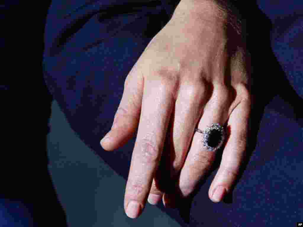 Kate Middleton wears the engagement ring of Diana, Princess of Wales, as she poses for the media with Britain's Prince William following the announcement of their engagement, at St. James's Palace in London. (AP Photo/Kirsty Wigglesworth)