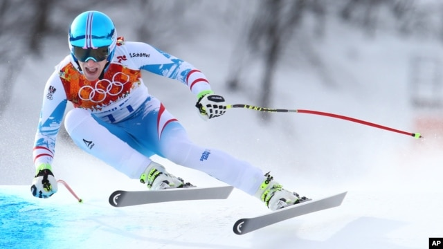 Austria's Matthias Mayer makes a turn in the men's downhill at the Sochi 2014 Winter Olympics, Feb. 9, 2014, in Krasnaya Polyana, Russia.