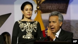 Ecuador's President Lenin Moreno gives a speech, as his wife Rocio Gonzalez listens to him, from the government palace balcony in Quito, Ecuador, May 24, 2017.