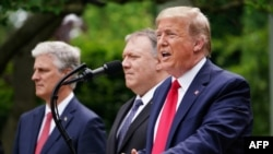 US National Security Advisor Robert O'Brien, and Secretary of State Mike Pompeo look on as US President Donald Trump speaks during a press conference on China in the Rose Garden of the White House in Washington, DC on May 29, 2020. - Washington D.C.