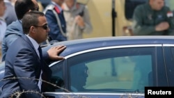 FILE - Members of the presidential guard surround the motorcade of Egypt's President Abdel Fattah al-Sissi in Cairo June 8, 2014.