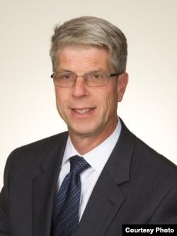 华盛顿市律师威廉姆•维格多(William Vigdor)
