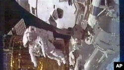 This image taken from video by NASA television shows astronaut Stephen Bowen during a spacewalk, February 28, 2011
