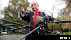 White House chief economic adviser Larry Kudlow speaks to reporters outside the White House in Washington, Nov. 13, 2018.