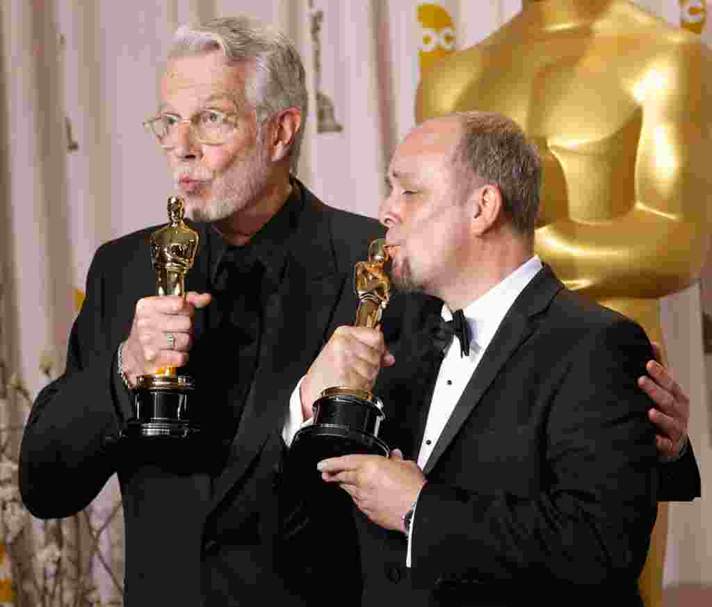 """Mark Coulier, left, and J. Roy Helland with their award for best achievement in makeup for """"The Iron Lady."""" (AP)"""