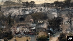 This aerial photo shows homes destroyed by a wildfire near Boomer Bay, in southern Australia, January 5, 2013.