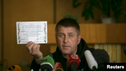 FILE - Vyacheslav Ponomaryov, separatist mayor of Slovyansk in eastern Ukraine, holds up a referendum ballot.