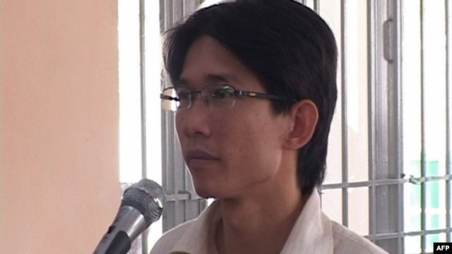 Activist Dinh Nhat Uy, 30, stands trial at a local People's Court in the southern city of Long An, Vietnam, Oct. 29, 2013.