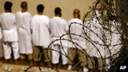 Detainees stand during an early morning Islamic prayer at the U.S. military prison in Guantanamo Bay, Cuba (2009 file photo)