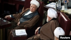 Iran's former President Hashemi Rafsanjani (L) attends Iran's Assembly of Experts' biannual meeting in Tehran, Iran, March 6, 2012.