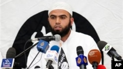 The radical Ansar al-Sharia group threatens to defy Tunisian government efforts to control its activities. Its spokesman, Saif Eddine Errais, speaks at a rally May 16, 2013.