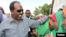 Somali President Hassan Sheikh Mohamud is greeted by children at Dadaab refugee camp in eastern Kenya, June 6, 2016. The camp, established in the early 1990s, houses more than 300,000 displaced Somalis. (via @TheVillaSomalia)