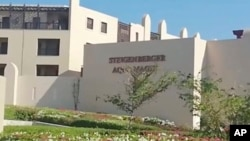 FILE - This Aug. 24, 2018, file photo taken from video shows the exterior of the Steigenberger Aqua Magic Hotel in Hurghada, Egypt. Egypt's chief prosecutor said Sept. 12, 2018, that tests showed that E.coli bacteria were behind the deaths of two British tourists in the hotel in the Red Sea resort of Hurghada.