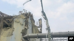 A machine collects radioactive material in the air for sampling at the Unit 3 reactor of Fukushima Daiichi Nuclear Power Station in Fukushima prefecture in this handout picture taken on June 13 and released on June 14, 2011