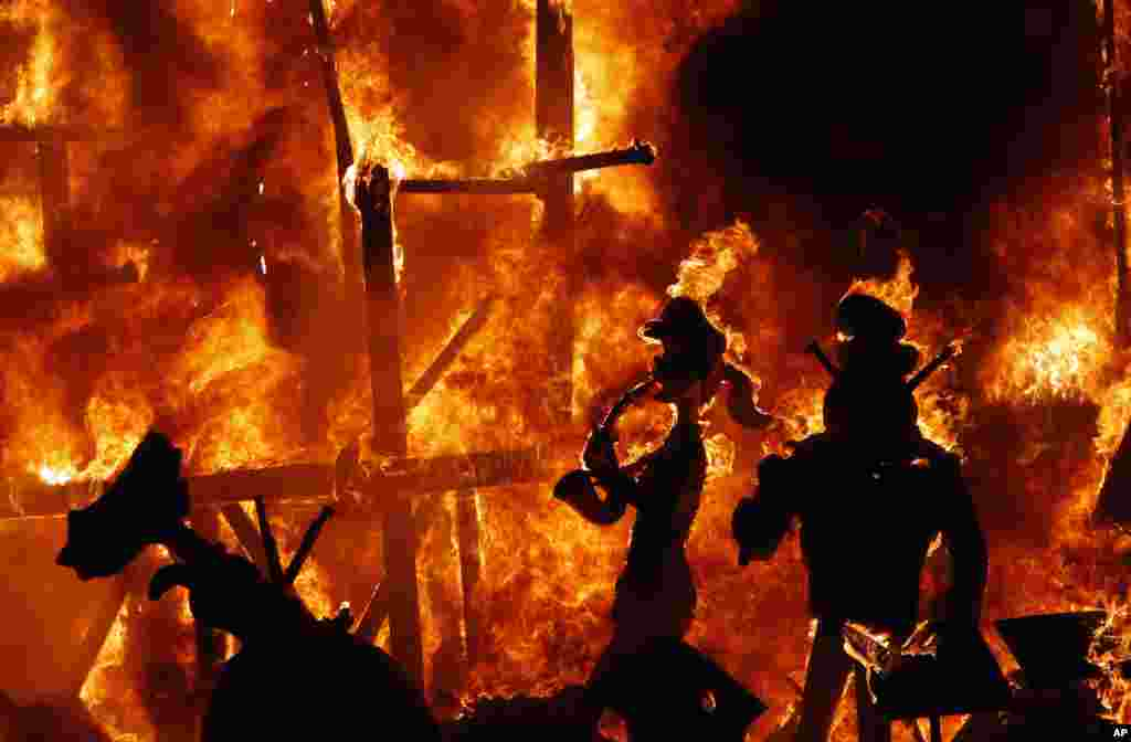 Satirical sculptures are burned during the traditional Fallas Festival, in Valencia, Spain.