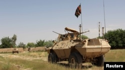 FILE - A military vehicle patrols in the Babaji area of Lashkar Gah Helmand province, Afghanistan, May 8, 2016. Afghan National Security and Defense Forces (ANDSF) entered Nawa district in southern Helmand province early Monday.