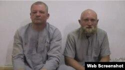 Григорий Цуркану (слева) и Роман Заболотний в плену у ИГИЛ