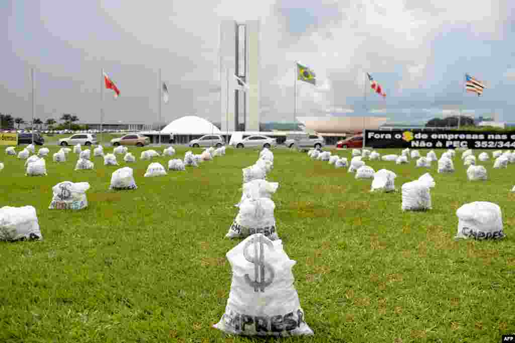Hundreds of fake money bags representing the donations from companies in election campaigns are placed in front of the National Congress in Brasilia. The protest was organized by the Coalition for Political Reform.