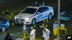 Investigators work at the scene where two NYPD officers were shot in the Bedford-Stuyvesant neighborhood of the Brooklyn borough of New York, Dec. 20, 2014.