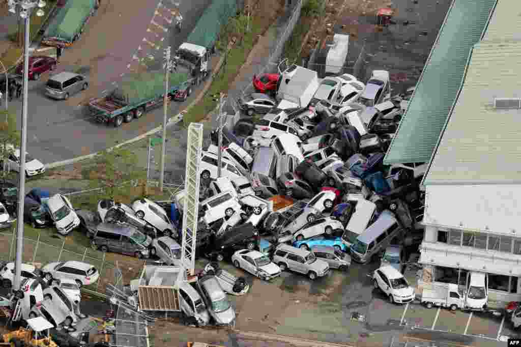 An aerial view from a Jiji Press helicopter shows vehicles piled in a heap due to strong winds in Kobe, Hyogo prefecture, after typhoon Jebi hit the west coast of Japan. The death toll in the most powerful typhoon to hit Japan in a quarter century rose to nine, with thousands stranded at a major airport because of storm damage.