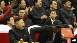 North Korean leader Kim Jong Un, left, and former NBA star Dennis Rodman watch North Korean and U.S. players in an exhibition basketball game, Pyongyang, Feb. 28, 2013.
