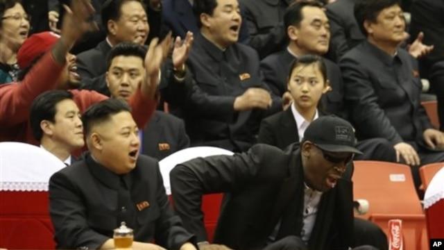 North Korean leader Kim Jong Un, left, and former NBA star Dennis Rodman watch North Korean and U.S. players in an exhibition basketball game, Pyongyang, Feb. 28, 2013.