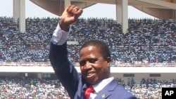 "FILE - Zambian President Edgar Lungu waves during his inauguration in Lusaka, Sept. 13, 2016. ""As president of this country it is my responsibility to respond to forestall chaos,"" he said Wednesday in reference to a state-of-emergency order he's seeking in the wake of the Lusaka City Market fire."