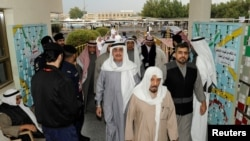 Kuwaiti men arrive to cast their votes during parliamentary election in a polling station in Kuwait City, Kuwait, Nov. 26, 2016.