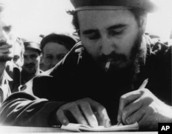 Fidel Castro is pictured at the front during the Bay of Pigs invasion in this 1961 photo.