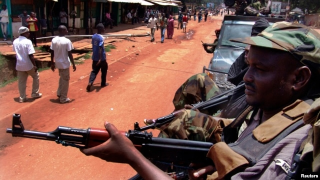 Armed fighters from the Seleka rebel alliance patrol the streets in pickup trucks to stop looting in Bangui, March 26, 2013.