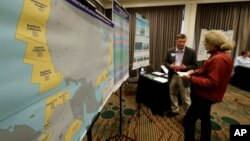 Areas that could potentially be leased for offshore oil and gas drilling are shown in yellow on a map displayed at an open house hosted by the federal Bureau of Ocean Energy Management to provide information and gather public comment on the Trump administration's proposal to expand offshore oil drilling off the Pacific Northwest coast, March 5, 2018.