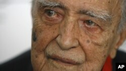 In this Dec. 12, 2007 file photo, Brazilian star architect Oscar Niemeyer attends his 100th birthday celebration, in Rio de Janeiro, Brazil.