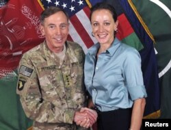General David Petraeus, former CIA chief and Commander of the International Security Assistance Force/U.S. Forces in Afghanistan, shakes hands with author Paula Broadwell in this handout photo from ISAF, originally posted July 13, 2011.