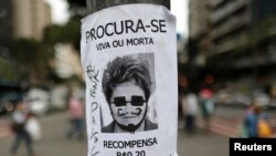 Defaced image of Brazil's President Dilma Rousseff displayed in Belo Horizonte, June 24, 2013.
