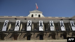 Carondelet presidential palace is shown with banners of black ribbons in honor of the victims kidnapped and recently killed by dissident FARC rebels on the Ecuador-Colombia border, taken in Quito on April 17, 2018. Two more people have been kidnapped on t