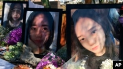 Yue Jiang is shown in large photographs at a memorial over two years after her death in Tempe, Ariz., June 11, 2018.