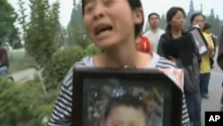 A parent protesting the shoddy construction of school buildings that collapsed in the 2008 Sichuan earthquake, killing thousands of children (file photo)