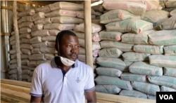 Trevor River, pictured May 16, 2020, sells building materials in one of Harare's poor townships. He says without government payouts, the lockdown is painful as his income was cut off in March when the lockdown started. (Columbus Mavhunga/VOA)