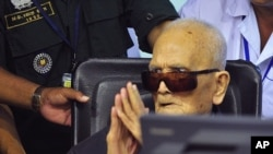 FILE - Nuon Chea, who was the Khmer Rouge's chief ideologist and No. 2 leader, sits in a court room before a hearing at the U.N.-backed war crimes tribunal in Phnom Penh, Cambodia, Nov. 16, 2018.