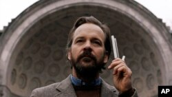 "This image released by IFC Films shows Peter Sarsgaard in a scene from ""The Sound of Silence."" (IFC Films via AP)"