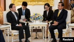 Thailand's Prime Minister Prayuth Chan-ocha and Japan's Minister of Foreign Affairs Fumio Kishida