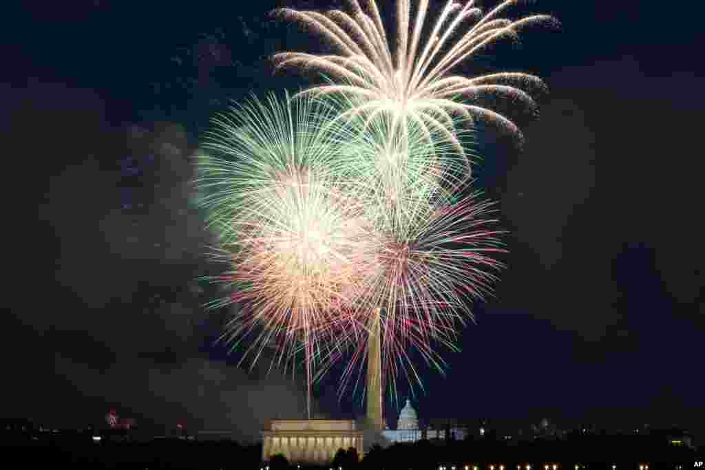 Fireworks explode over Lincoln Memorial, Washington Monument and U.S. Capitol, at the National Mall, during the Independence Day celebrations, in Washington, on July 4, 2021.