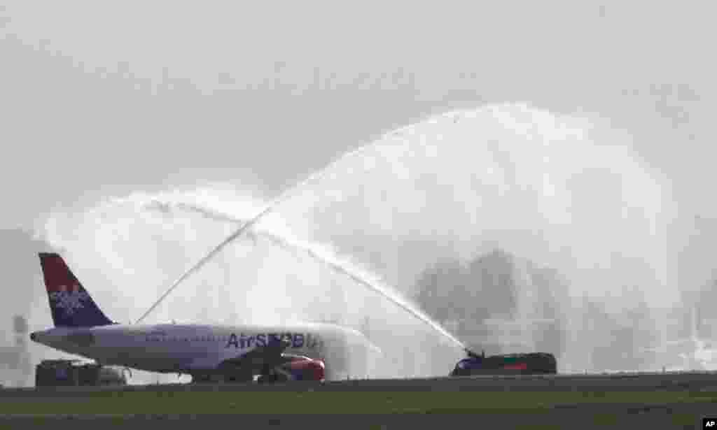The first Airbus A319-100 aircraft in the Air Serbia livery is welcomed with spouts of water at the Belgrade's Nikola Tesla Airport, Serbia.